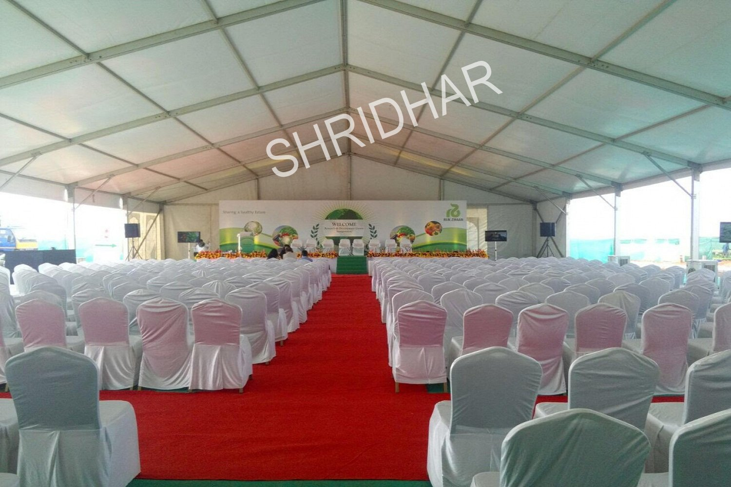 banquet chairs covered red synthetic carpets and wooden stages for rent for conferences in bangalore shridhar tent house